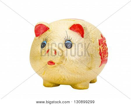 Golden piggy bank isolated over white background