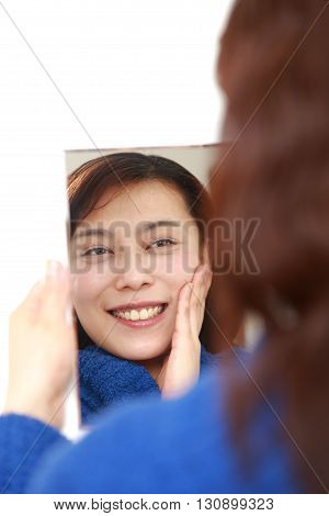 portrait of Asian woman with good condition skin on white background