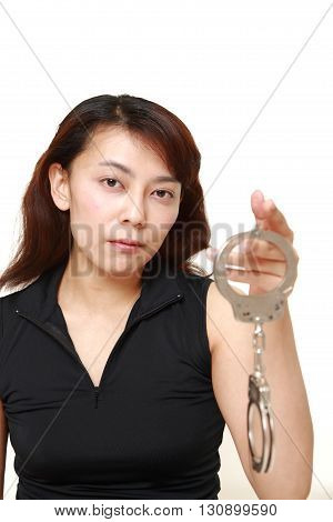 studio shot of an woman with handcuffs