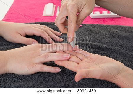 In Nail Salon Girl Receiving A Manicure By A Beautician