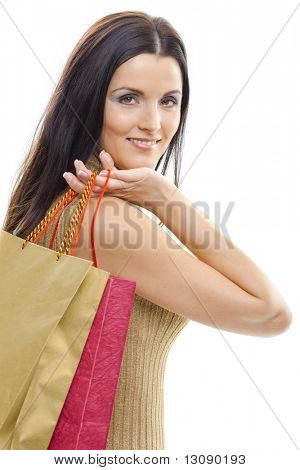 Closeup portrait of attractive young woman holding shopping bags. Isolated on whte.