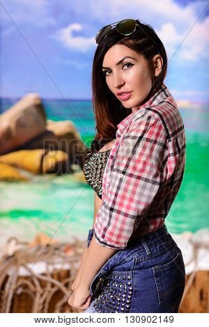 Girl Brunette In A Plaid Shirt And Shorts