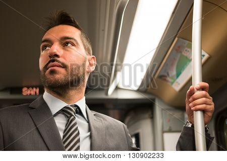 Portrait of a man traveling in a subway train
