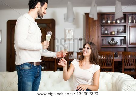 Young couple celebrating with champagne glasses
