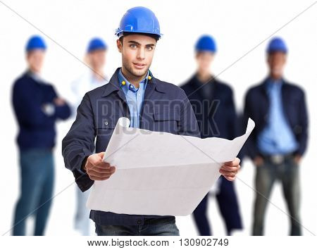 Portrait of an engineer holding a drawing in front of his team
