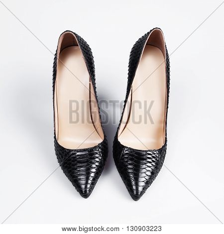 Elegant expensive black high heel women shoes on white background
