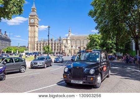 London England - June 28 2008: Trafic in Parliament square with the Westminster palace in the background