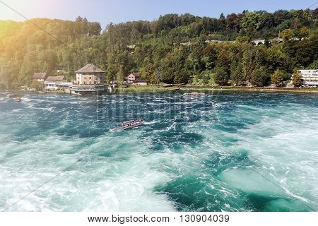 Tourist boat near rheinfall. The biggest waterfall in Europe.