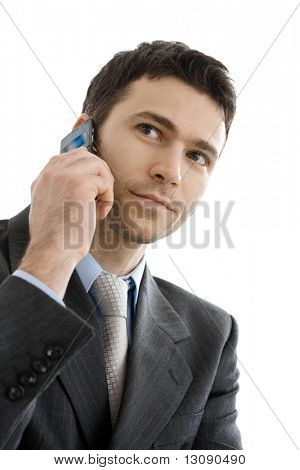 Closeup portrait of casual businessman talking on mobile phone. Isolated on white.