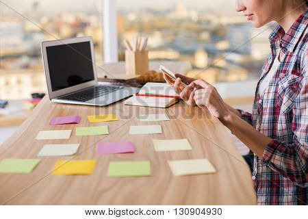 Girl Using Phone In Office