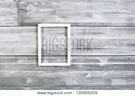 Blank see-through frame on antique wooden background. Mock up