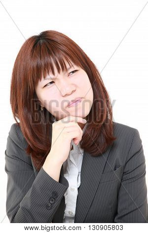 portrait of portrait of young Japanese businesswoman worries about something on white background