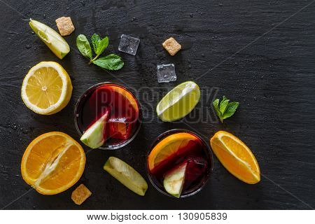 Sangria and ingredients on stone background, top view