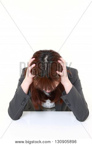 portrait of portrait of a depressed businesswoman on white background