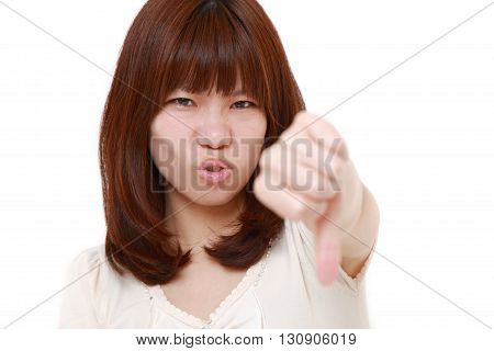 portrait of woman with thumbs down gesture on white background
