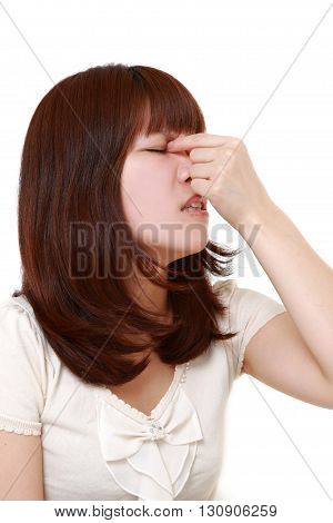 portrait of woman suffers from Asthenopia on white background