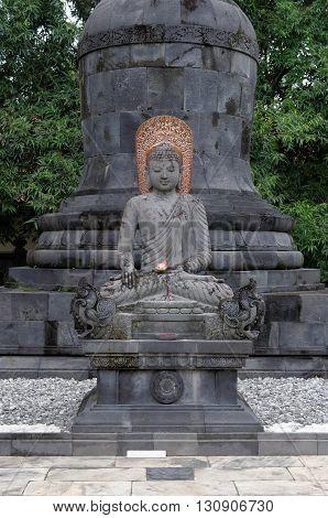 buddha aksobhya statue in mendut buddhist monastery