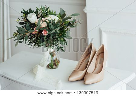 Bridal Bouquet Of Peones With White Shoes
