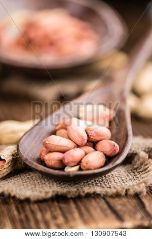 Some Fresh Peanuts On Wooden Background