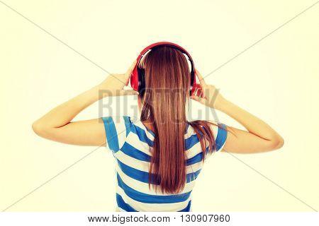 Teenage woman with red headphones