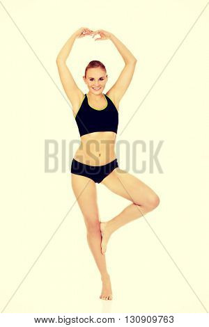 Yuong athletic woman doing balet pose