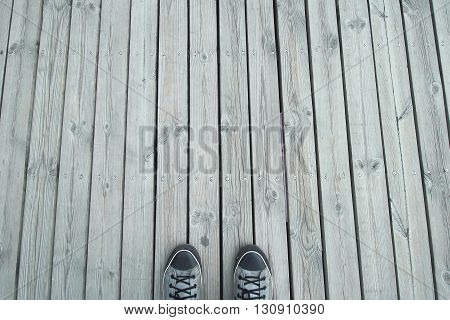 Gray Sneakers On Wooden Background