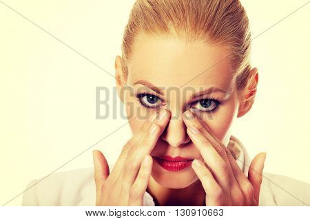 Young business woman with sinus pressure pain