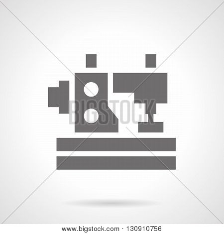 Monochrome silhouette of sewing machine with two spools of thread. Work with cloth, symbol for tailoring atelier. Professional sewing equipment. Symbolic black glyph style vector icon.