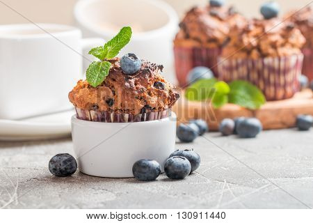 Carrot muffins with blueberrie on  gray  background