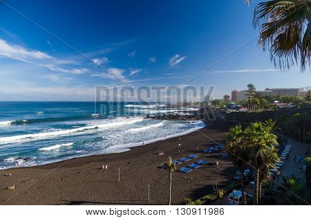 PUERTO DE LA CRUZ SPAIN - JANUARY 21 2016: Majestic view of giant waves and black sand of Playa Jardin beach.