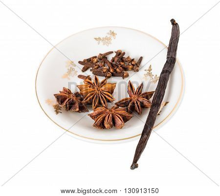Vanilla pod with anise stars and cloves for christmas mulled wine. Isolated on a white background.