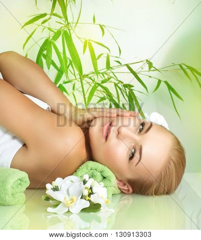 Portrait of a beautiful gentle girl relaxing on a massage table, medical therapy in a beauty salon, healthy lifestyle, enjoying dayspa on a luxury spa resort