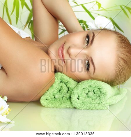 Closeup portrait of a beautiful gentle woman relaxing on a massage table, medical therapy in a beauty salon, healthy lifestyle, enjoying dayspa on a luxury spa resort