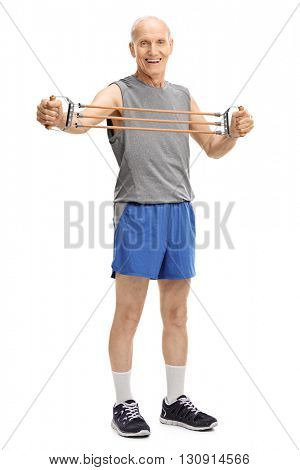 Full length portrait of an active senior exercising with a resistance band isolated on white background