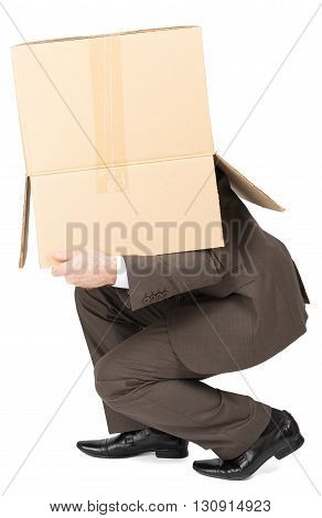 Businessman in suit wearing carton box on head isolated on white background