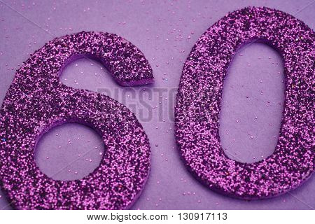 Number sixty purple color over a purple background. Anniversary. Horizontal