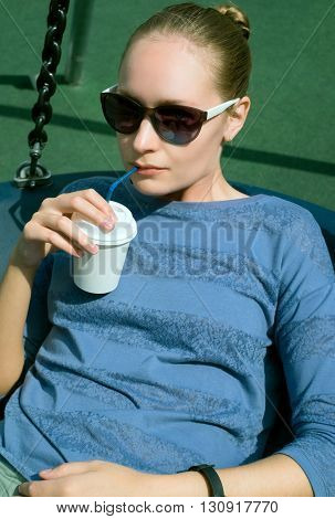 Girl In Sunglasses Drinking Coffee From A Paper Cup
