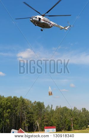 RUSSIA NOGINSK - AUGUST 7 2015: The helicopter MI-8 in the sky on doctrines of rescuers of Ministry of Emergency Situations of Russia.