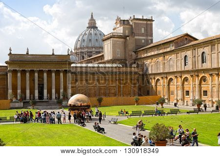 VATICAN - SEPTEMBER 23 2015: Sphere within sphere in Courtyard of the Pinecone at Vatican Museums. Sphere was created in 1990 by Italian sculptor Arnoldo Pomodoro.