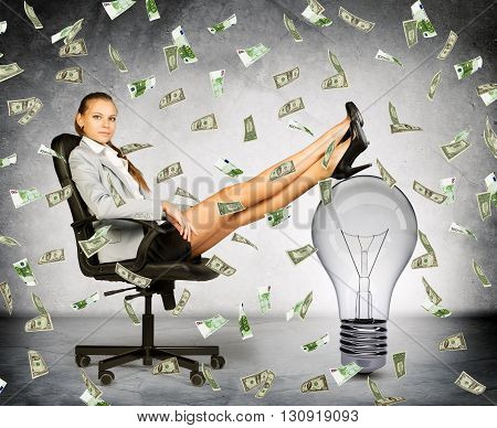 Businesswoman with light bulb and money rain, idea is money concept