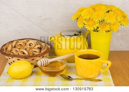 Tea With Honey And Lemon, Bagels And Bouquet