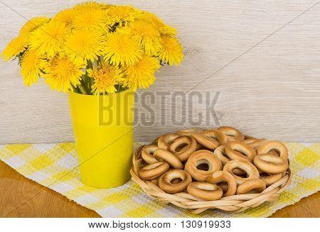 Bouquet Of Dandelions And Wicker Basket Of Bagels