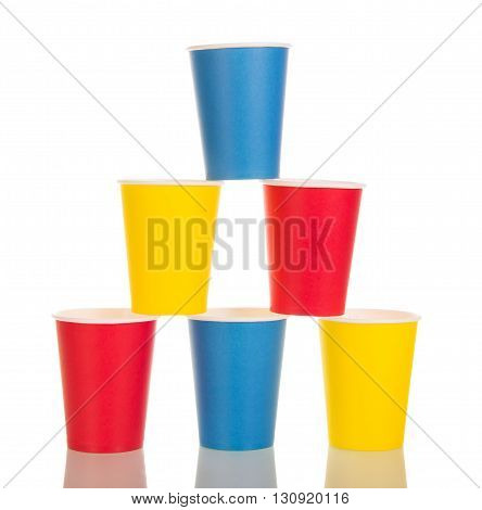Pyramid of bright paper disposable cups isolated on white background.