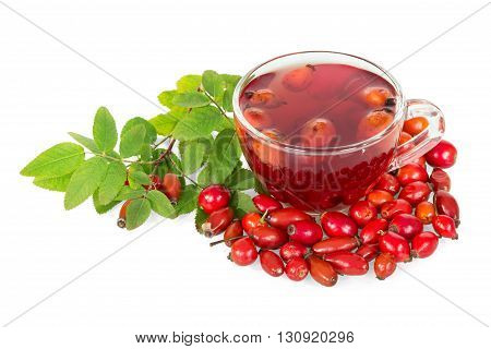 Rosehips and a cup of tea isolated on white background.