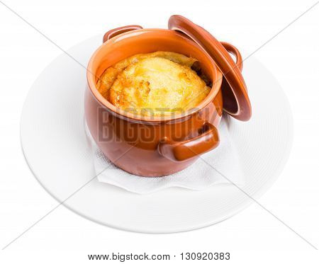 Pork sausages on crock pot covered with cheese. Isolated on a white background.