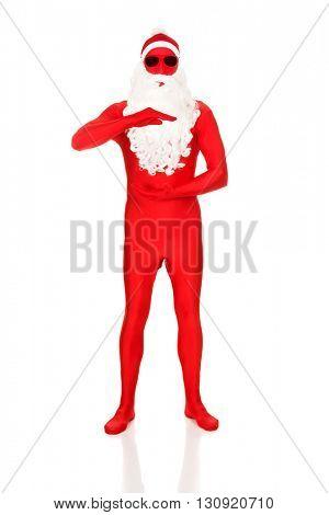 Santa in latex clothing holding copyspace