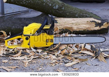 the yellow chainsaw is on a ground