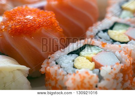 Set of sushi with salmon and roll scallop macro photo