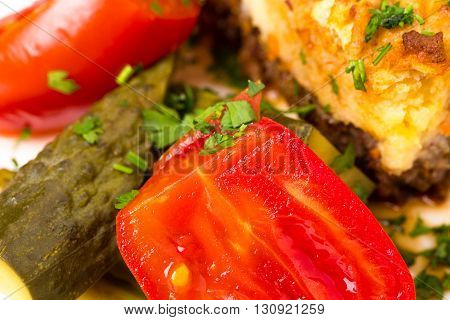 Marinated vegetables and traditional shepherd pie with lamb forcemeat. Macro. Photo can be used as a whole background.