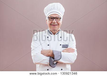 Studio shot portrait of happy kitchen chef.